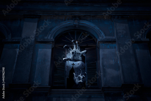 Stampa su Tela Zombie hand rising out from old damaged window with wall over cross, church, bir