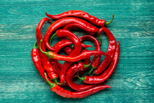 Red Hot Chili Peppers On Green Background - Flat Lay