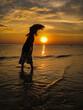 Leinwandbild Motiv Silhouette Woman On Beach During Sunset