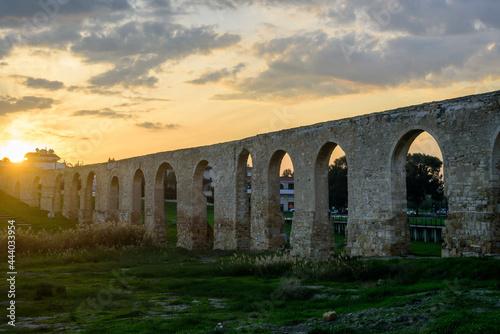 Murais de parede Kamares Aqueduct near Larnaca at sunset