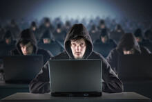 Many Hackers In Troll Farm. Security And Cyber Crime Concept.