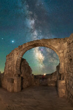 Ancient Stone Ruins Under Starry Sky With Milky Way