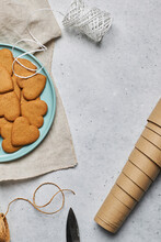 Christmas Cookies On Plate Placed On Table With Wrapping Supplies