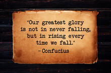 """""""Our Greatest Glory Is Not In Never Falling, But In Rising Every Time We Fall."""" Inspirational Quote On Old Paper Vintage Retro Background. Ancient Chinese Philosopher Confucius Quote."""