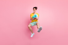 Photo Of Crazy Violent Funky Guy Jump Shot Pump Water Gun Wear Yellow T-shirt Shorts Footwear Isolated On Pink Background