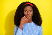 Photo Portrait Of Curly Girl Shut Mouth With Hand Keeping Secret Isolated On Vivid Yellow Color Background