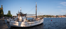 Old Fishing Boats At The Stockholm City Town Hall Pier At Sunset