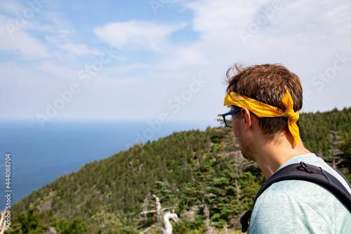 A man looking at the beautiful nature of cape breton nova scotia Fototapeta