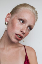 Model Wearing Red Top And Earrings