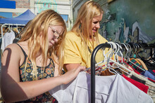 Mother And Daughter Shopping At Flea Market