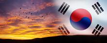 South Korea Waving Flag With Birds On The Beautiful Orange Sunset Background