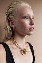 Young Model Wearing Earrings And Necklace