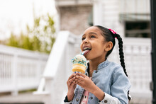 Young Girl Licking An Ice Cream Cone
