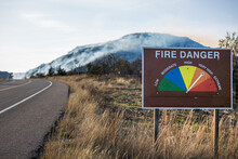 Fire Danger Warning Sign With Smoke In The Background