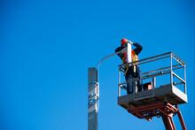 Worker In Lift Bucket Repair Light Pole