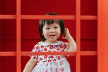 Cute Child Portrait In Red Frame