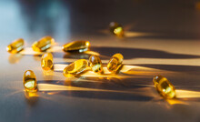Cod Oil Capsule On Counter With  Vitamin D