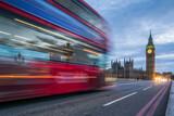 Fototapeta Paryż - Red double-decker bus crossing the Westminster Bridge in London at night