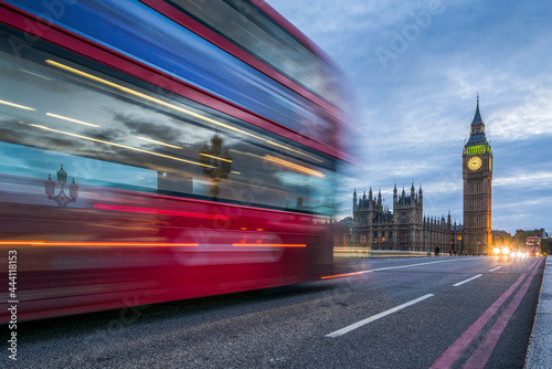Stampa su Tela Red double-decker bus crossing the Westminster Bridge in London at night