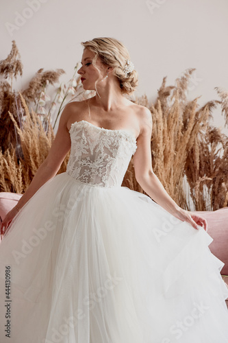Tela Bride in white dress, lace bodice. A look aside.