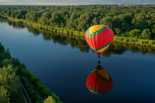 Hot Air Balloon Flying Over Lake