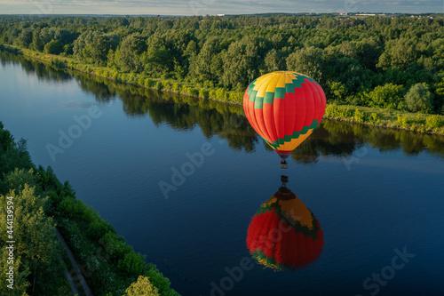 Fotografie, Obraz Hot Air Balloon Flying Over Lake