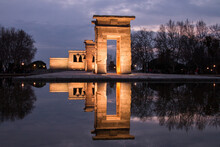 Reflection Of Building In Lake At Dusk. Debod Temple