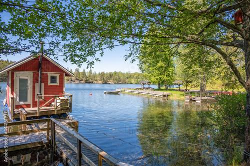 House By Lake Against Trees Fotobehang