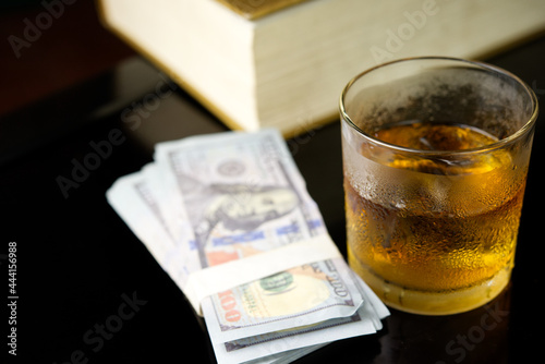 Wallpaper Mural Alcohol offenses concept.Glass of whiskey with moneys.