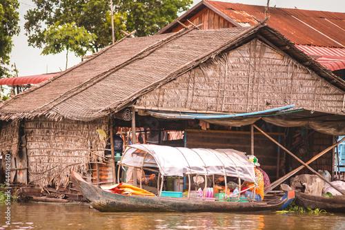 Boathouse Beside Stilted House In Tonle Sap Fotobehang