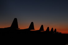 Silhouette Of Army Airplanes During Sunset