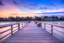 View Of Pier On Bridge Against Sky During Sunset