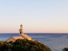 Church By Sea Against Clear Sky