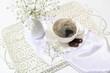 Leinwandbild Motiv Tray with cup of coffee and beautiful gypsophila flowers on light table