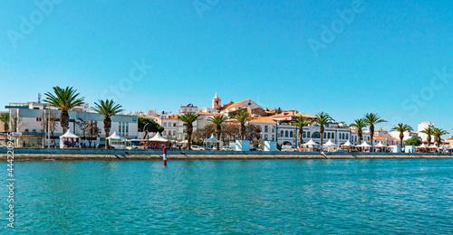 Fotografia View Of Waterfront Against Buildings