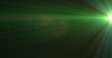 Glowing green rays of light moving against black background