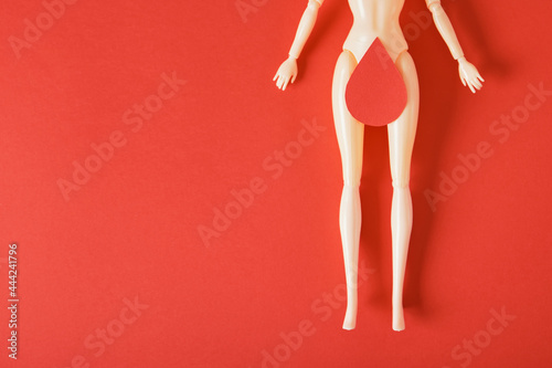 Valokuvatapetti doll with a paper drop of blood on the thighs, feminism art, women's health and