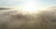 Flying Above Low Clouds At Sunrise