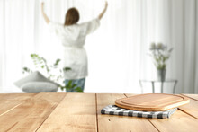 Slim Young Woman With Window And Wooden Desk Of Free Space For Your Deocration