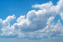Natural Daylight And White And Dark Blue Clouds Floating On Blue Sky. White Fluffy Clouds And Blue Sky