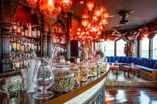 Wooden Ornate Counter In Modern Bar