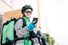 Young Delivery Woman Using GPS Map