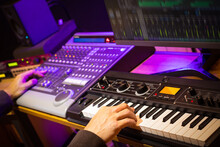 Music Producer, Arranger, DJ Hands Remixing Music On Synthesizer Keyboard, Control Surface And Computer In Home Recording Studio