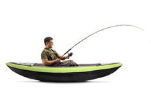 Side Shot Of A Young Man Catching Fish From A Canoe