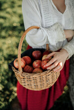 Woman In Vintage Clothes With Basket Of Fruits