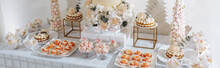 Candy Bar At The Banquet. Wedding Table With Sweets, Cake, Pastries, Muffins, Sugar Treats. Event In The Restaurant