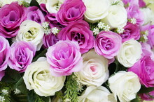 Multi-colored Fake Roses Are Arranged In A Bouquet.