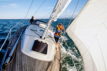 Father And Young Daughter On Yacht Sailing On Calm Water