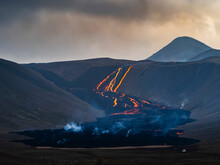 Glowing Lava Cascade Flowing Steeply Downhill, Fagradalsfjall Volcano, Iceland