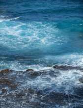 Cooled Black Lava Beaten By The Atlantic Ocean Waves. View Of Sea Waves Hitting Rocks On The Beach. Waves And Rocks.